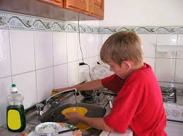boy washing dish